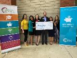 Sharonview delivers check the the Hispanic Alliance of South Carolina