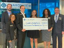 Sharonview delivers check to Charlotte Family Housing