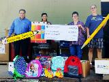 Sharonview delivers check and supplies to Classroom Central