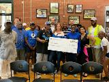 Sharonview delivers check to RunningWorks