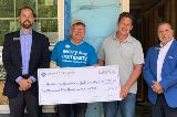 Sharonview delivers check to Habitat for Humanity