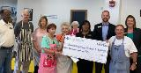 Sharonview delivers check to Spartanburg Soup Kitchen